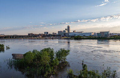 Missouri river flood of 2019 at Omaha Nebraska, Swollen Missouri River overflowing its banks and flooding the Omaha riverfront and Tom Hanafan plaza,  in Council Bluffs Iowa. Omaha downtown skyline in the distance.