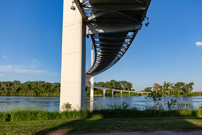 Missouri River Flood of 2019 in Omaha Nebraska, Bob Kerrey foot bridge over swollen missouri river