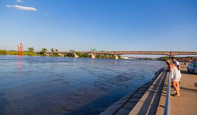 Missouri River Flood of 2019 at Omaha. Swollen Missouri river running under Douglas Street Bridge at Omaha. Omaha Riverfront is on the right.
