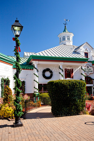 The shops and stores decorated for Christmas at the Grand Village Shopping Center in Branson, Missouri, USA.