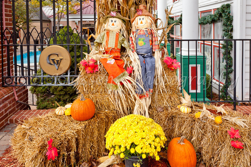 A fall public display of scarecrow, pumpkins, flowers and corn stalks at the Grand Village Shopping Center in Branson, Missouri, USA.
