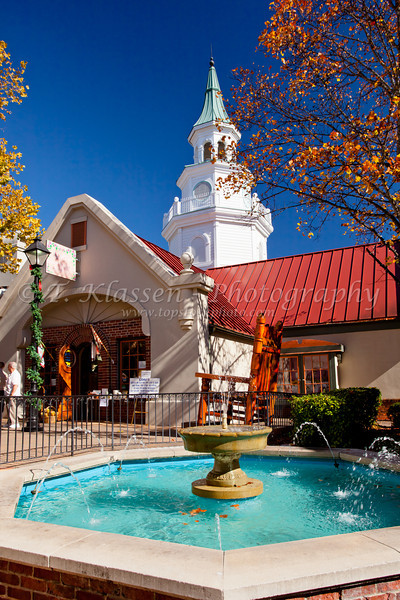 A decorative water fountain with shops and stores at the Grand Village Shopping Center in Branson, Missouri, USA.