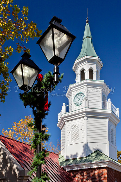 A decorative lamp post and bell tower in the Grand Village Shopping Center in Branson, Missouri, USA.