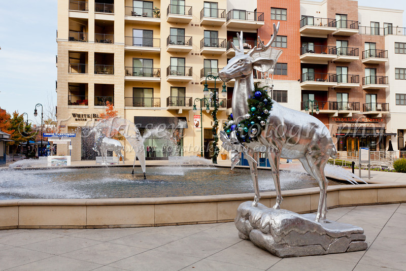 Silver deer statues decorated for Christmas at the Branson Landing shopping center in Branson, Missouri, USA,