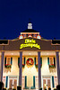 The Dixie Stampede theater decorated for Christmas and illuminated at night in Branson, Missouri, USA.