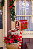 A decorative mailbox and poinsettia flowers at the Christmas Village decorted for the season in Branson, Missouri USA.