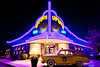 The Uptown Cafe illuminated at night with vintage 1953 Henry J Kaiser car in Branson, Missouri, USA.