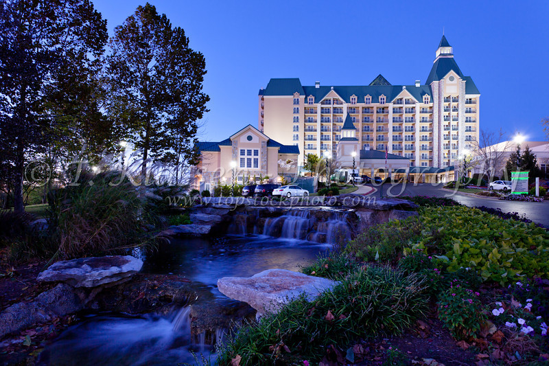 The Chateau on the Lake hotel and resort illuminated at dusk in Branson, Missouri, USA.