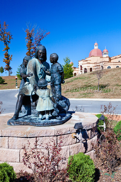 Jesus and Children statue at the exterior of the Sound and Light Show theater in Branson, Missouri, USA.