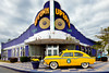 The Uptown Cafe with vintage 1953 Henry J Kaiser yellow car in Branson, Missouri, USA.