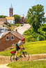 Cyclist climbing toward Gasconade County Courthouse in Hermann, Missouri - C3-0105 - 72 ppi