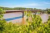 Cyclist on bridge over Missouri River at Hermann, Missouri - C3-0200 - 72 ppi