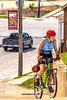Cyclist climbing toward Gasconade County Courthouse in Hermann, Missouri - C3-0102 - 72 ppi-3