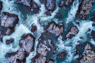 Aerial drone views of Johnson's Shut-Ins State Park, located in Reynolds County, Mo and is known for the rock formations along the East Fork of the Black River. The destination in the St. Francis Mountains is a popular swimming hole during the summer as kids and adults alike slide down the shuts, explore the water potholes and jump into the clear, cool water.    Photo by Kyle Spradley Photography  © Kyle Spradley Photography | www.kspradleyphoto.comJohnson's Shut-Ins State Park is located in Reynolds County, Mo and is known for the rock formations along the East Fork of the Black River. The destination in the St. Francis Mountains is a popular swimming hole during the summer as kids and adults alike slide down the shuts, explore the water potholes and jump into the clear, cool water.    Photo by Kyle Spradley Photography  © Kyle Spradley Photography | www.kspradleyphoto.com