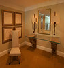 Hung pictures, mirror and installed a glass table on wall mounted pedestals.