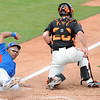 Chicago Cubs Marion Byrd slides into home plate for the go ahead run.