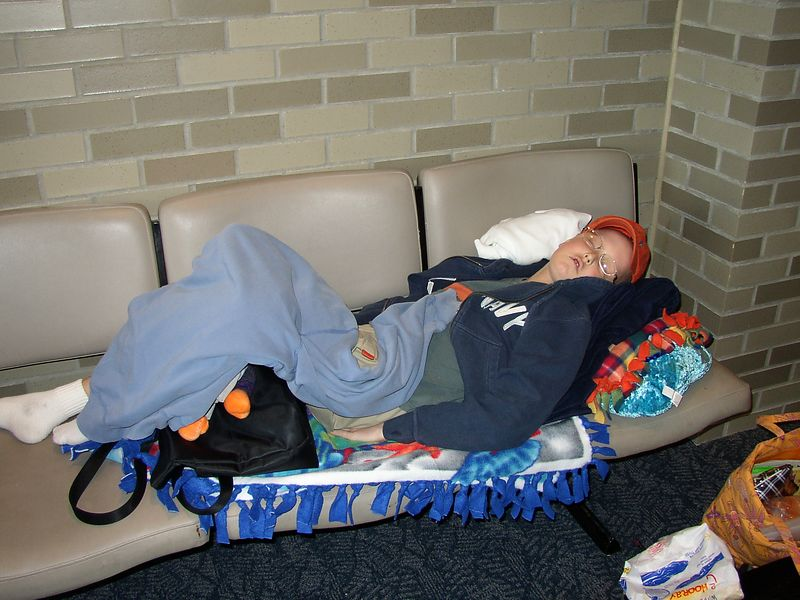 Sleeping in the airport during lay-over on our way to San Jaun