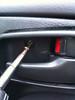 Removing door handle trim bezel screw