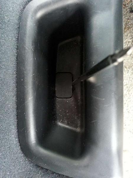 7 - remove screw cover from door handle