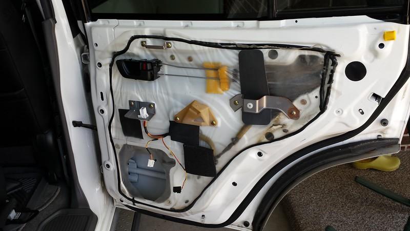 Factory speaker and bracket removed from door