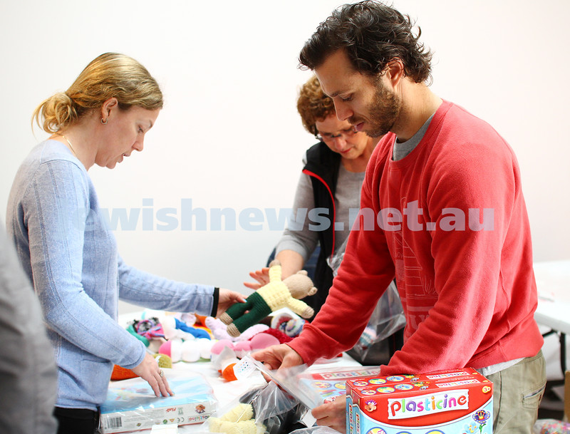 16-11-14. Mitzvah Day, Melbourne 2014. KOGO (Knit One Give One) / Impact. Packing gifts for people excaping domestic violence. Photo: Peter Haskin