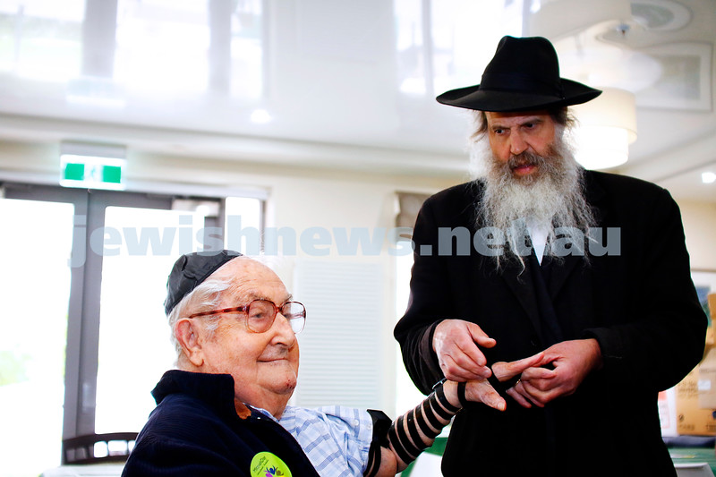 27-11-16. Mitzvah Day.  Leo Cooper putting on teffilin at Gary Smorgon House. Photo: Peter Haskin