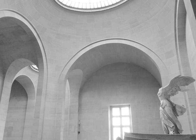 Winged Victory and one of the Louvre's magnificent spaces.