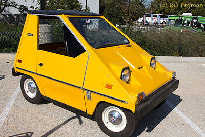 Electric CitiCar.  Note the receptacle behind the front wheel for connecting electrical power.