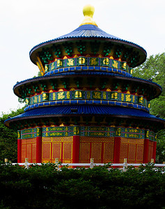 A really large and ornate lantern in the shape of a pagoda