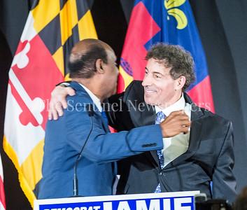 Ike Leggett hugs Jamie Raskins at Jamie Raskins Democratic Resistance Revival in Silver Spring MD