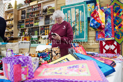 Stephanie Lovell, of Sew Nanie Sew, sales her handmade crafts. 04 01 2017 Bethesda Farmers Market opening day