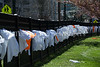 A student-organized exhibit spans the fron fencing at Bethesda-Chevy Chase High School. The exhibit memorializes the 199 teen victims of gun violence in 2018. PHOTO BY MIKE CLARK