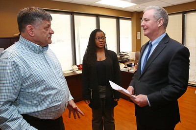 George P. Smith/The Montgomery Sentinel    Silver Spring Vet Center Director Wayne L. Miller, a Licensed Master Social Worker and US Marine Corps veteran, and Office Manager Ashley Lee,  with U.S. Sen. Chris Van Hollen during a recent visit to the Center.