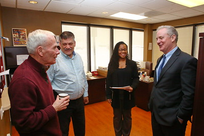 George P. Smith/The Montgomery Sentinel    U.S. Sen. Chris Van Hollen visits with Silver Spring Vet Center staff during a recent visit - (L-R) Counselor George Bendict, who was an E-6 in the US Army, Vet Center Director Wayne L. Miller, a Licensed Master Social Worker and US Marine Corps veteran, and Office Manager Ashley Lee, who is a 25-Bravo Information Technology Specialist in the Maryland National Guard.