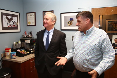 George P. Smith/The Montgomery Sentinel    Silver Spring Vet Center Director Wayne L. Miller, a Licensed Master Social Worker and US Marine Corps veteran who served in Vietnam, gives U.S. Sen. Chris Van Hollen a tour of the Center during a recent visit.