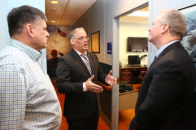 George P. Smith/The Montgomery Sentinel    Silver Spring Vet Director Wayne L. Miller, a Licensed Master Social Worker and US Marine Corps veteran (left) listens as US Army Chaplain (Maj.) Wayne A. Stinchcomb, a Veterans Outreach Program Specialist at the Center, describes the Center's services to U.S. Sen. Chris Van Hollen during a recent visit.