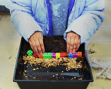George P. Smith/The Montgomery Sentinel    A student uses dirt, blocks, and gravel to do an experiment on erosion control.