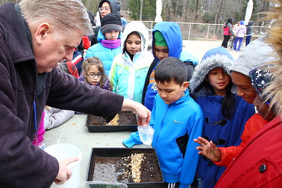 George P. Smith/The Montgomery Sentinel    Chris Horne, and environmental educator from Frederick County Public Schools, shows the kids an experiment about erosion and erosion control.