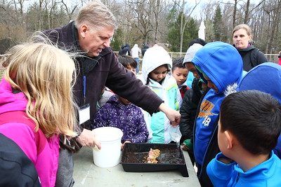 George P. Smith/The Montgomery Sentinel    Chris Horne, from FCPS, shows the kids an experiment about erosion and erosion control.