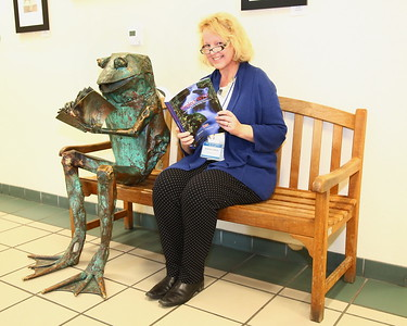 "George P. Smith/The Montgomery Sentinel    Brookside Gardens Director Stephanie Oberle joins the iconic Brookside frog in reading about Project WET. ""WET"" stands for ""Water Education for Teachers""."
