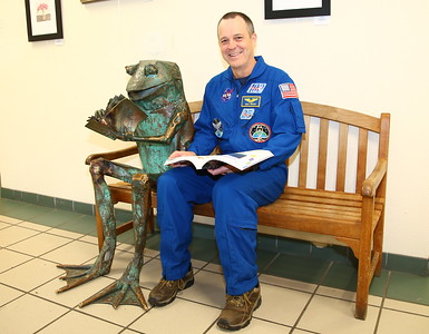 George P. Smith/The Montgomery Sentinel    Astronaut and teacher Ricky Arnold gets into the spirit of the day reading about water with the iconic Brookside Gardens frog. Arnold is a Bowie native and has degrees from Frostburg and the University of Maryland. See http://spaceflight101.com/iss/ricky-arnold/
