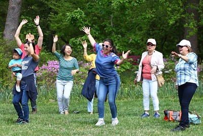George P. Smith/The Montgomery Sentinel    Alejandra Sorto of Alexandria Va dances with other visitors to the sounds of the Latin Pop/Rock Band Ocho de Bastos perform at the Fifth Annual Montgomery County GreenFest held jointly with Brookside Gardens' Earth Day Celebration on Sunday, April 28, 2019 at Brookside Gardens in Wheaton.