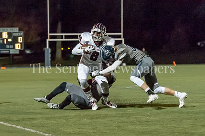 11/4/2016 - Episcopal running back Shedler Fervius (8) is tackled by by Georgetown Prep defenders Justin Allen (2) & Beau Hanley (21), ©2016 Jacqui South Photography