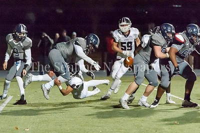 11/4/2016 - Episcopal linebacker Vincent Notzon (24) slams Prep halfback Tillman Dozier (7) knocking the ball loose. Episcopal lineman Luiji Vilain (10) falls on the ball scoring a touchdown, putting the Maroon ahead of the Hoyas 10-7 with 6 minutes remaining in the 4th quarter, ©2016 Jacqui South Photography