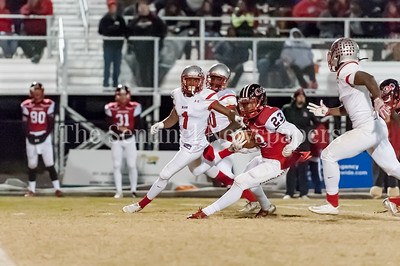 November 11, 2016 - Quince Orchard running back Marvin Beander looks to get by three Blair defenders led by corner back Clifford Carter (1).