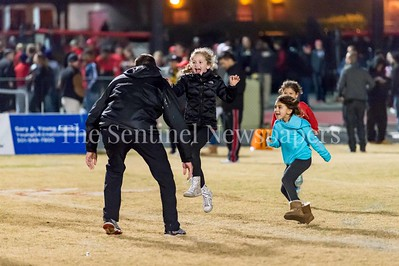 11/19/2016 - Quince Orchard head coach John Kelley is greeted by his daughter after the Cougars defeat the Richard Montgomery Rockets 49-23 in the 4A West Regional Playoff game, ©2016 Jacqui South Photography