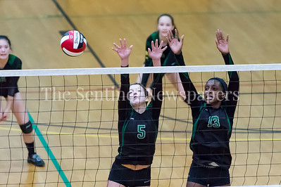 11/20/2016 - Kaylen Bernota (5) and Rose Opara (13) block the ball during the 3A Championship Volleyball game between Atholton and Damascus, ©2016 Jacqui South Photography