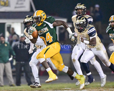 Damascus sophomore T.D.Ayo-Durojaiya breaks free of any would-be Potomac tackles and scores a touchdown.