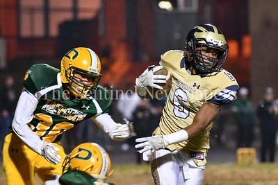 Potomac senior wide receiver slips Damascus' Micah Thrope.