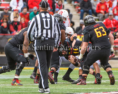 Terps QB Perry Hills gets sacked.